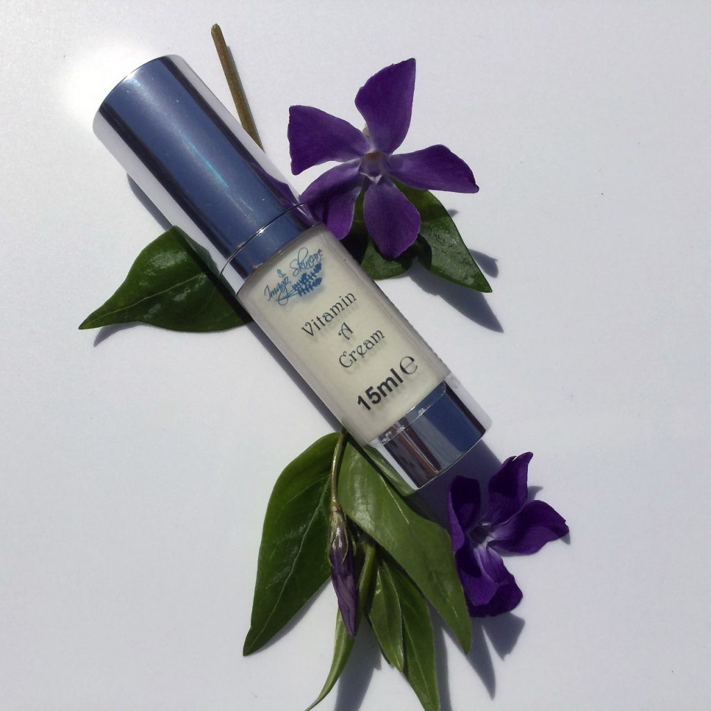 Picture of 15ml Vitamin A Cream with purple flowers and green leaves